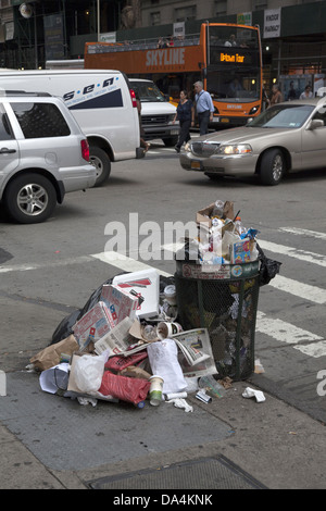 The Dept.of Sanitation cannot keep up with the amount of trash deposited each day on the streets of midtown Manhattan. - Stock Photo