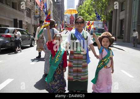 Tibetan refugees and & full fledged Tibetan Americans march in the International Immigrants Day Parade in New York - Stock Photo