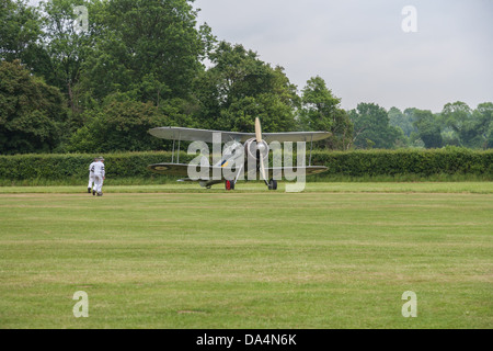 Gloster Gladiator K7985 L8032 G-AMRK at D-Day air show in Shuttleworth (Old Warden) Aerodrome - Stock Photo