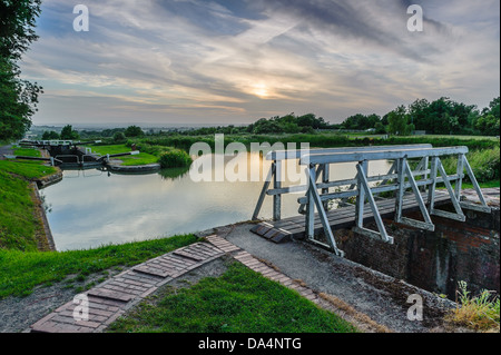 Sunset over Caen Hill Locks on Kennet and Avon Canal - Stock Photo