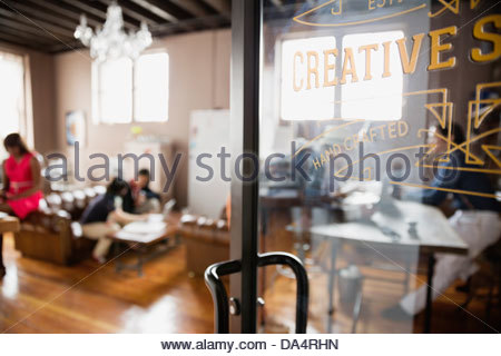 Close-up of door in creative office space - Stock Photo