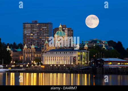 Full moon rising above Provincial Legislature and Inner harbor-Victoria, British Columbia, Canada.  Note-Digital - Stock Photo