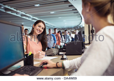 Young students registering for classes at college campus - Stock Photo
