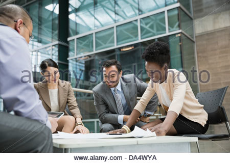 Businesspeople having meeting in office building - Stock Photo