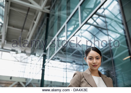 Portrait of businesswoman in office building - Stock Photo