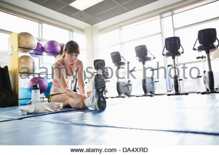 Woman stretching in fitness center - Stock Photo