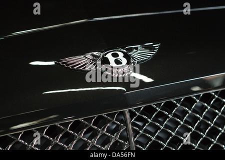 Close-up of Bentley logo on black limousine. - Stock Photo