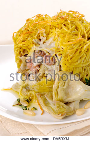 artichokes and pasta timbale - Stock Photo