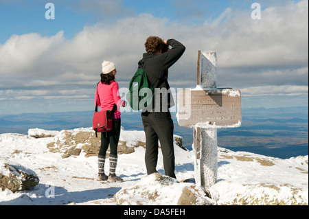 Hikers enjoying the view from the summit of Mt Lafayette, New Hampshire, USA. - Stock Photo