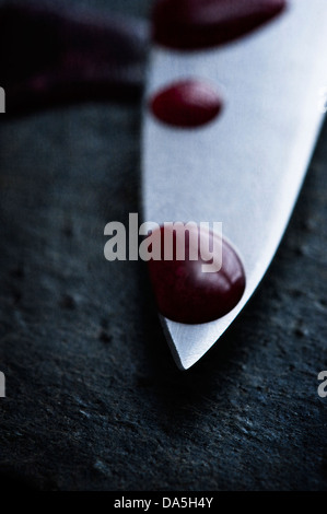 point of  murder weapon knife with blood drops - Stock Photo