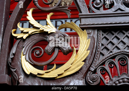 London, England, UK. Raoal Academy of Arts - detail of main gate with traditional red phonebox behind - Stock Photo