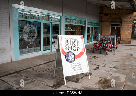 Bicycle hire shop, with cycle stand,  near the train main-line railway station in the city of York, Yorkshire, England, - Stock Photo