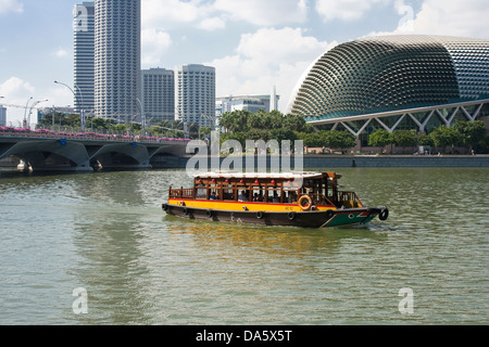 sightseeing boat on the Singapore River, the skyline of Singapore, Marinabay, Esplanade drive,Theatres on the Bay - Stock Photo
