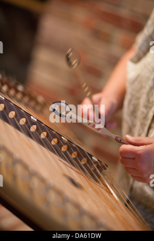 Hammered dulcimer being played with mallets. - Stock Photo