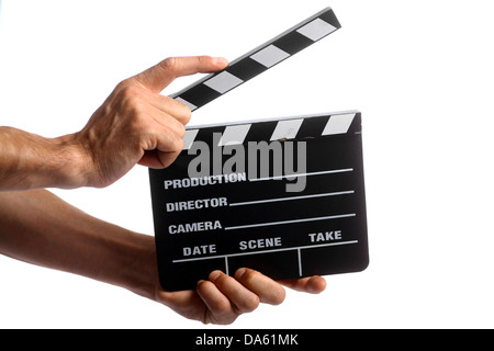 Two hands holding a cinema clap isolated on white - Stock Photo
