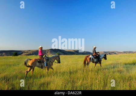 Pacific Northwest, American west, Oregon, USA, United States, America, cowgirl, girl, woman, cowboy, prairie, grassland, - Stock Photo