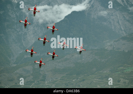 SION, SWITZERLAND, Swiss air force PC-7 team in formation at the Breitling Air show.  September 17, 2011 in Sion, - Stock Photo