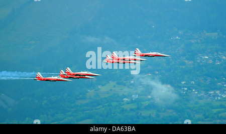 SION, SWITZERLAND, Patrouille suisse in close formation at the Breitling Air show.  September 17, 2011 in Sion, - Stock Photo