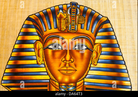 Painting of Tutankhamun's death mask on papyrus paper, Cairo, Egypt - Stock Photo