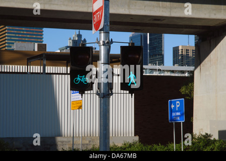 Green traffic light for pedestrians and bicycles. Brisbane, Queensland, Australia. - Stock Photo