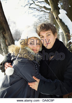 Portrait of young couple in winter clothes - Stock Photo