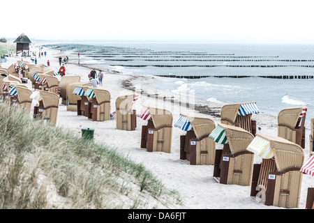 Roofed wicker beach chairs on a beach on the Baltic Sea coast