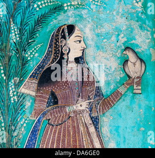 Woman holding a dove, wall painting or fresco painted with natural colours from the Bundikalam school of painting, - Stock Photo