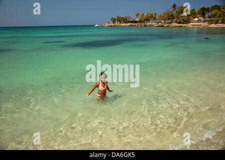 Little Cuban girl on Playa Bacuranao beach - Stock Photo