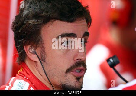 Nuerburg, Germany. 05th July, 2013. Spanish Formula One driver Fernando Alonso of Ferrari seen in his teamgarage - Stock Photo