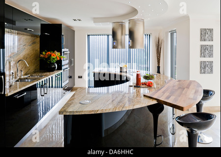 ... Breakfast Bar On Curved Central Unit With Marble Worktop In Large  Modern Kitchen   Stock Photo