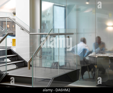 Argent Offices, London, United Kingdom. Architect: Morey Smith, 2013. Interior view showing stair with meeting taking - Stock Photo