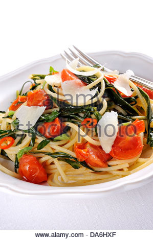 spinach and cherry tomatoes spaghetti - Stock Photo