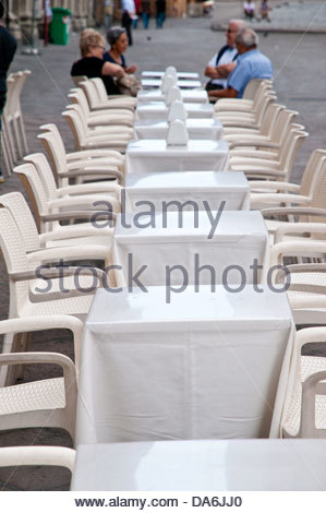 tourists sitting at a table in a bar,bologna - Stock Photo