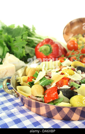 a noodle dish with vegetables and ham strips - Stock Photo