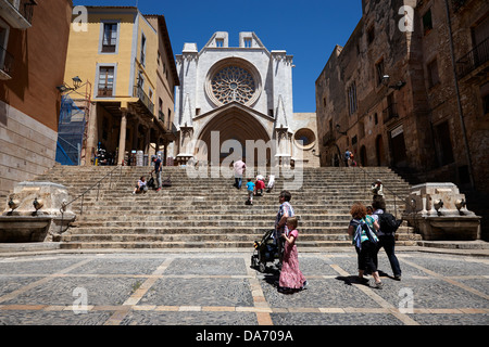 tourists on steps leading up to facade of tarragona cathedral catalonia spain - Stock Photo
