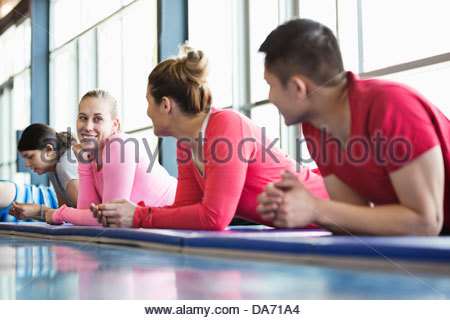 Group of people taking a break in fitness class - Stock Photo