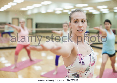 Group of women doing yoga in fitness class - Stock Photo