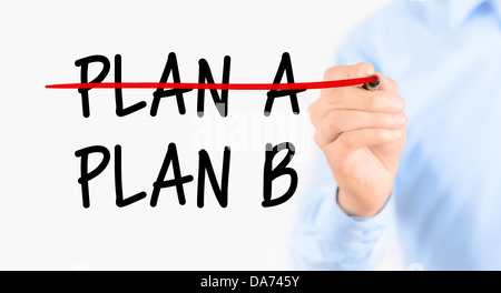Business plan strategy changing. Businessman crossing over plan A, writing plan B. Isolated on white background. - Stock Photo