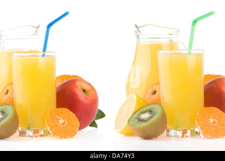 ripe fruits and juice in glass isolated on white background - Stock Photo