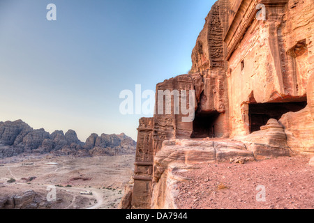 Ancient tombs carved in the rock in Petra, Jordan - Stock Photo