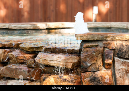 Swimming pool spa with waterfall and fountain. - Stock Photo