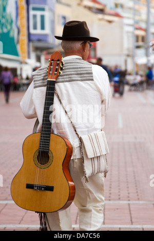 Folk Musicians with guitars on back - Stock Photo