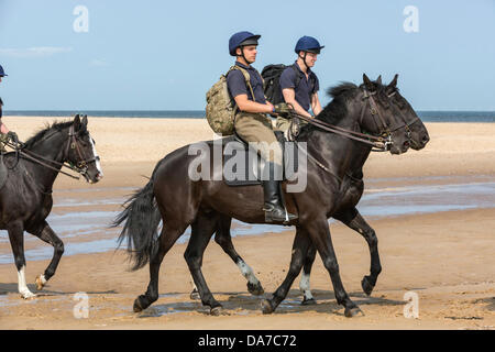 Holkham, Norfolk, UK. 4th July, 2013. The Household cavalry - Riders of the Blues and Royals riding on Holkham beach - Stock Photo