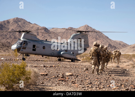 US Marines with the 23rd Marine Regiment walk toward a CH-46 Sea Knight helicopter during a training exercise June - Stock Photo