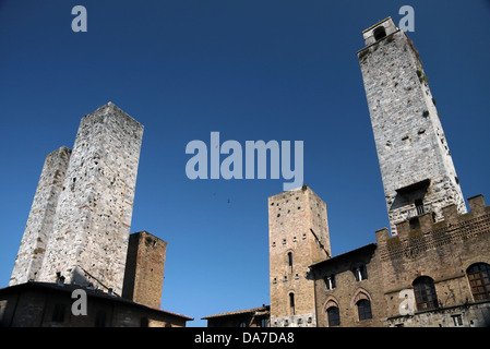 Market square of San Gimignano in Tuscany, Italy - Stock Photo