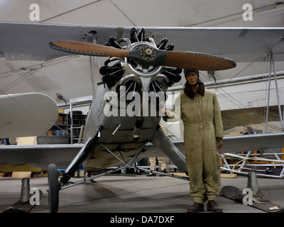 Dummy model aviator and old German biplane machine with Siemens-Halske Sh 14 radial engine. - Stock Photo