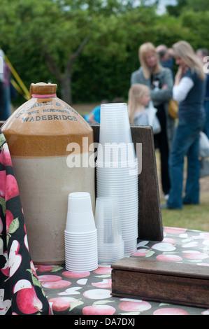 Cider flagon for testing at Blickling Hall Fair, Norfolk, UK. - Stock Photo