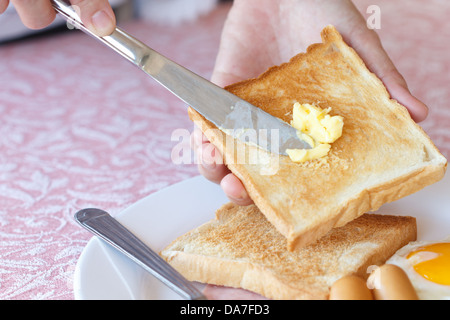 Buttered toast for breakfast to eat with coffee - Stock Photo