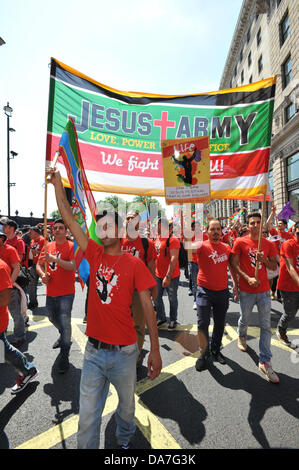 Piccadilly, London, UK. 6th July 2013. The Jesus Army passes along Piccadilly. Credit:  Matthew Chattle/Alamy Live - Stock Photo