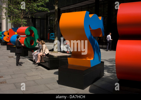 City workers talk by an art installation entitled 'One Through Zero (The Ten Numbers)' by American pop artist Robert - Stock Photo